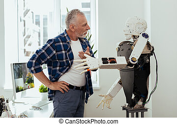 Serious aged man having a conversation