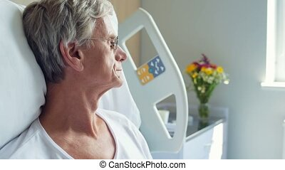 Serious aged man lying in the hospital bed - Think out your...