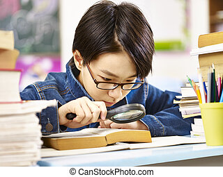 serious and curious asian elementary schoolboy - asian pupil...