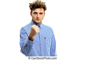 Serious angry man showing fist over white background