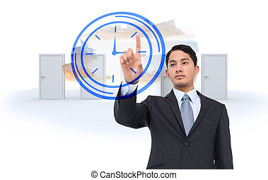 Serious asian businessman pointing
