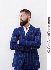 Serious attractive businessman in blue suit