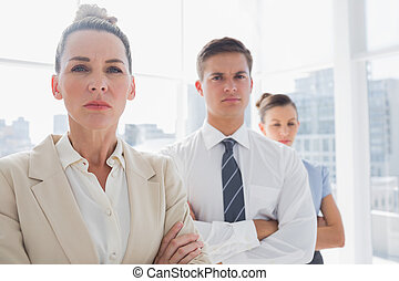 Serious attractive businesswoman standing with arms crossed