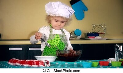 Serious beautiful child girl with chef hat add flour and mix...
