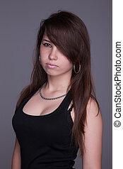 serious beautiful woman, looking up, studio shot