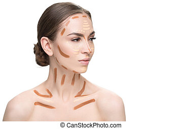 Serious beautiful woman using concealers - Thoughtful...