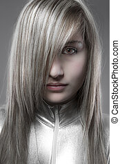 Serious blond, concept future and modernity, young girl with...