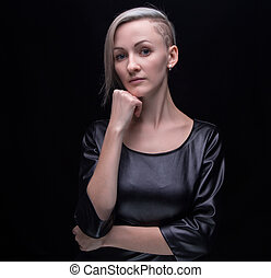 Serious blond woman in leather dress