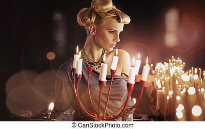Serious blonde attractive woman keping candlestick