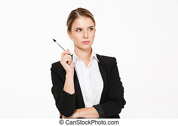 Serious blonde business woman holding pen and looking away