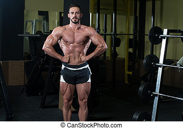 Serious Body Builder Standing In The Gym
