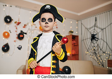 Serious boy at Halloween party