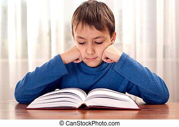 Serious boy makes homework