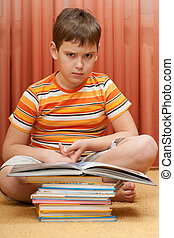 Serious boy with a books
