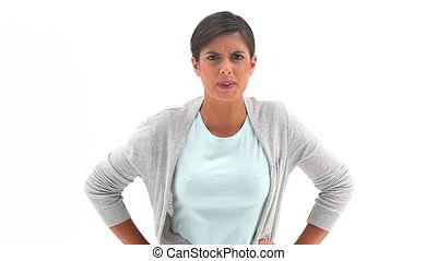 Serious brunette woman arguing against a white background