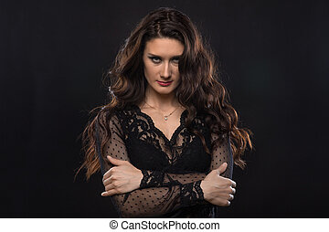 Serious brunette woman with arms crossed