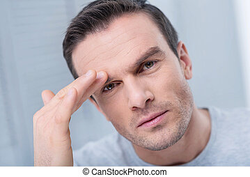 Serious budding  man has headache