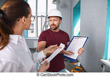 Serious builder showing the contract to his client