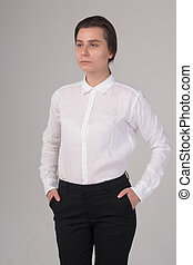 Serious business girl looks aside isolated