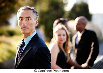 Serious Business Man - An Asian business man with a serious...