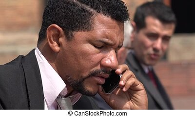 Serious Business Man Talking On Cell Phone