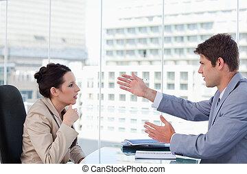 Serious business team negotiating