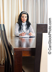 Serious business woman at table