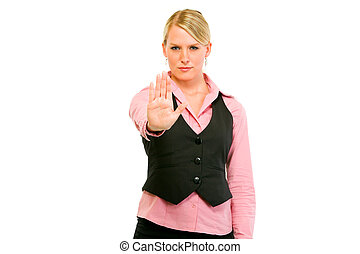 Serious business woman showing stop gesture isolated on...