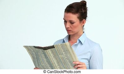 Serious business woman with a newspaper crossing her arms