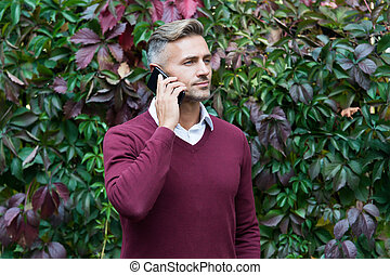 serious businessman answer the phone call, business call