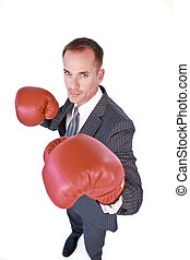 Serious businessman boxing against white background