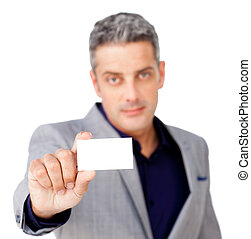 Serious businessman holding a white card