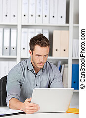 Serious Businessman Looking At Laptop