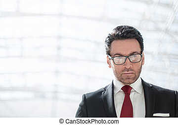 serious businessman looking at you