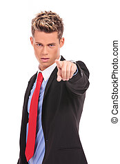 serious businessman pointing accusing finger