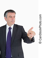 Serious businessman pointing on something