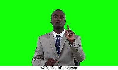 Serious businessman scrolling through items on a virtual touchscreen