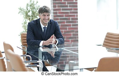 Serious businessman sitting at the desk