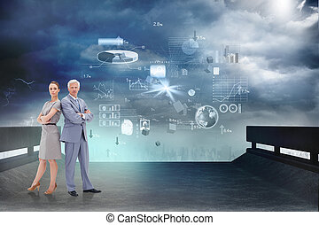 Serious businessman standing back to back with a woman against computer applications