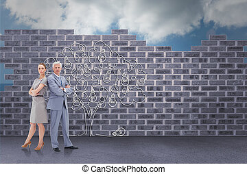 Serious businessman standing back to back with a woman  against light bulb tree doodle against wall