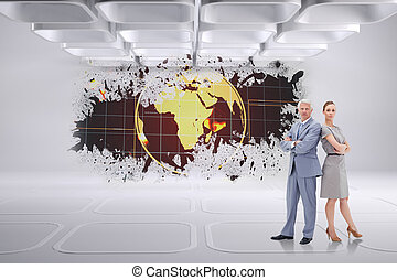 Serious businessman standing back to back with a woman  against splash showing earth graphic