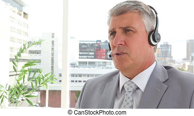 Serious businessman talking on a headset
