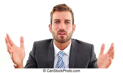 Serious businessman talking to camera
