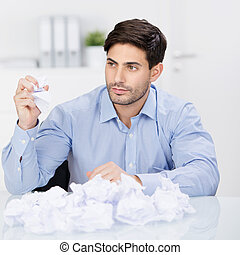 Serious businessman tearing up a document, contract or ...