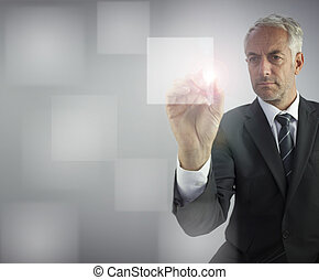 Serious businessman touching empty pane on digital screen -...