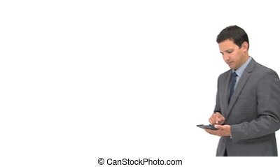 Serious businessman using a computer tablet