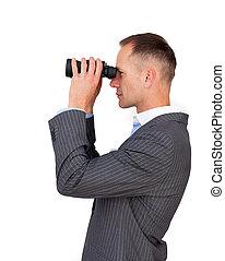 Serious businessman using binoculars