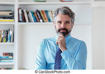 Serious businessman with grey hair and necktie