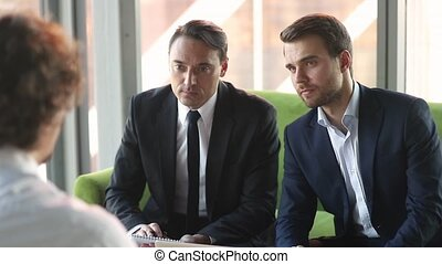Serious businessmen employers listening talking to applicant...