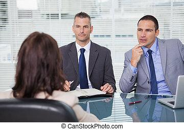 Serious businessmen having an interview